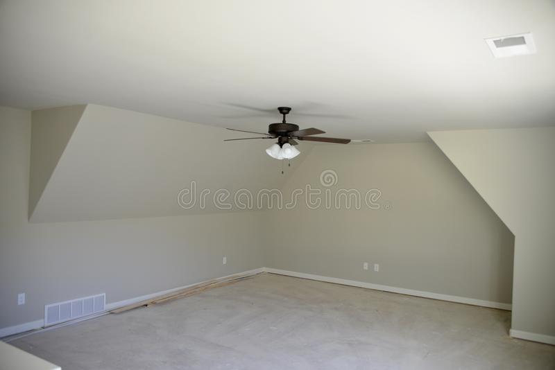Ceiling Fan in a Bedroom. A ceiling fan in a freshly painted and newly remodeled bedroom that will be set-up as a man cave stock image