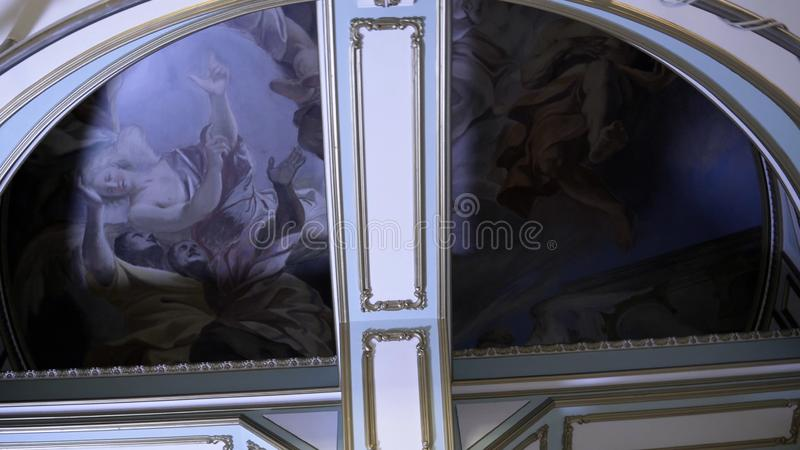 Ceiling with frescoes and gold patterned column. Footage. Beautiful antique interior architecture with picturesque. Frescoes and patterned ceiling skirting royalty free stock images