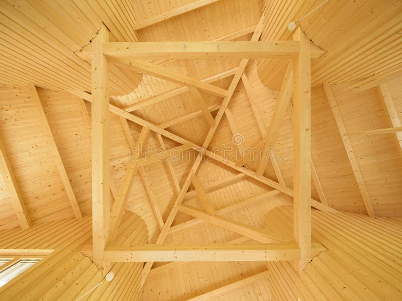 Ceiling with geometric pattern of wooden beams. Closeup of roof modern house royalty free stock images