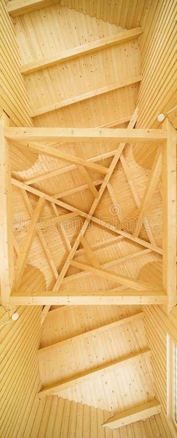 Ceiling with geometric pattern of wooden beams royalty free stock images