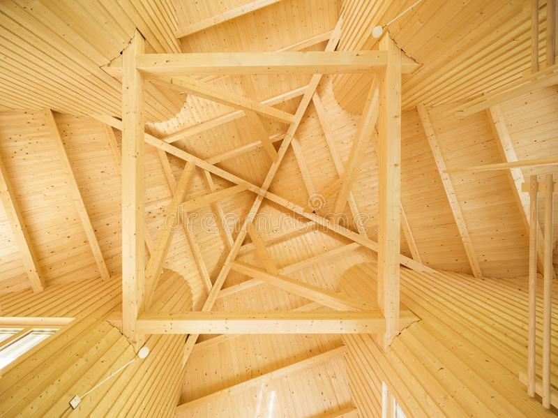 Ceiling with geometric pattern of wooden beams stock photos