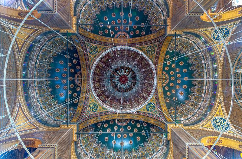 Ceiling of the great Mosque of Muhammad Ali Pasha decorated with golden and blue floral patterns, Citadel of Cairo in Egypt royalty free stock images