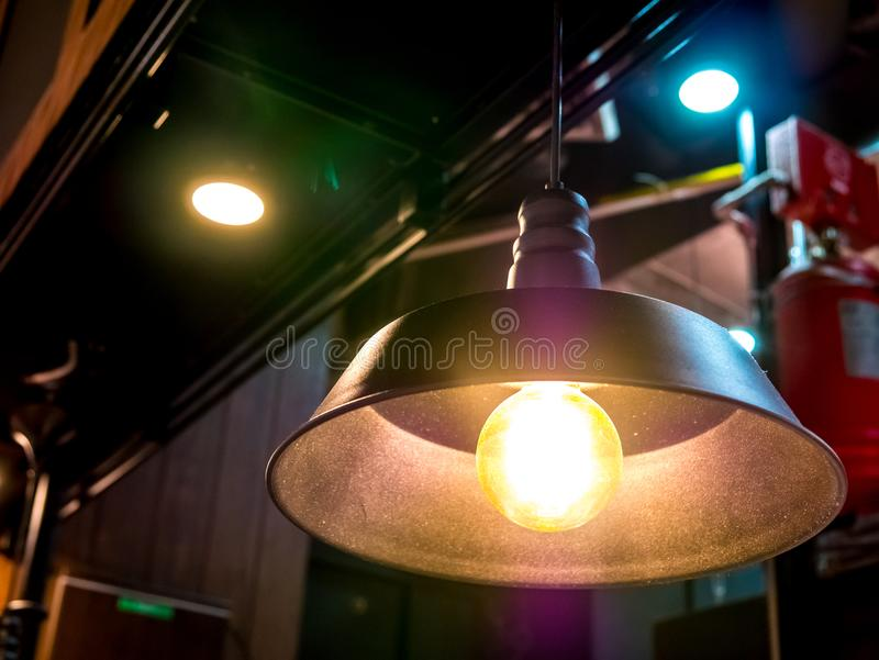 Ceiling lamp electric light in the dark room high contrast art abstract object background blur no people.Low angle view. stock photos
