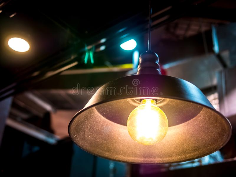 Ceiling lamp electric light in the dark room high contrast art abstract object background blur no people.Low angle view. stock images