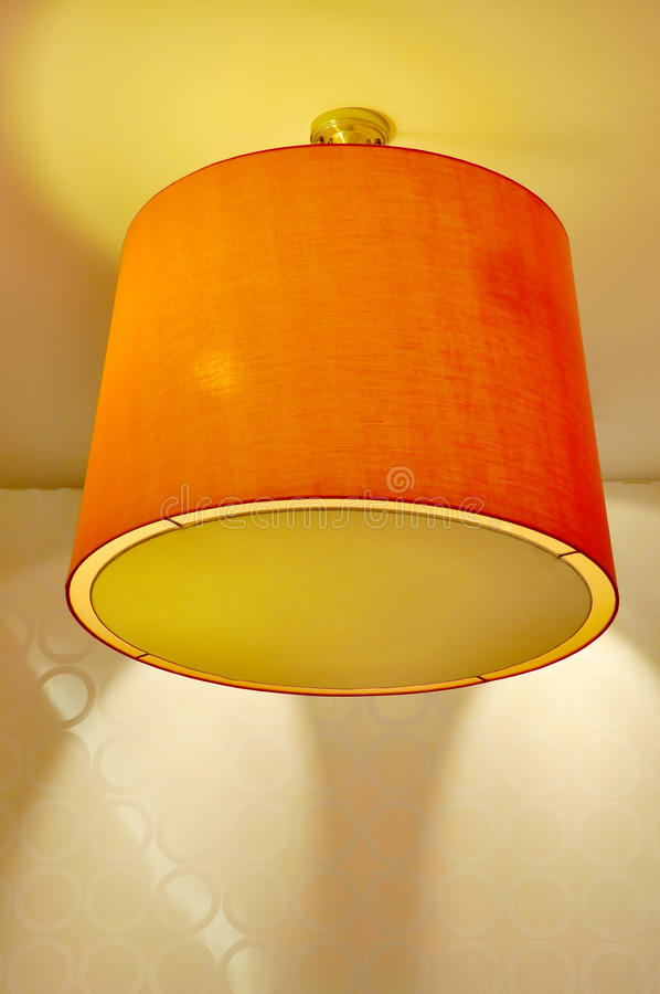 Ceiling Lamp with Orange Lampshade royalty free stock images