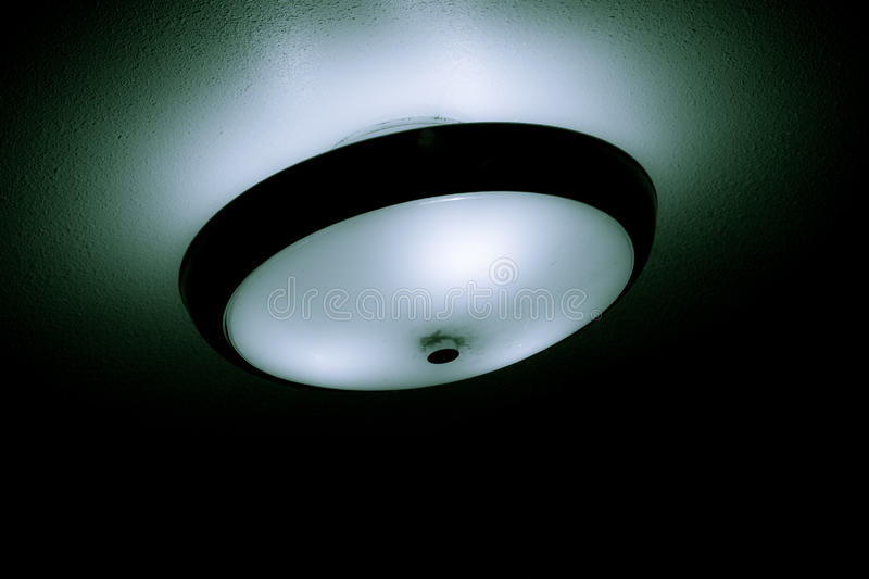 Ceiling light with glow royalty free stock photography