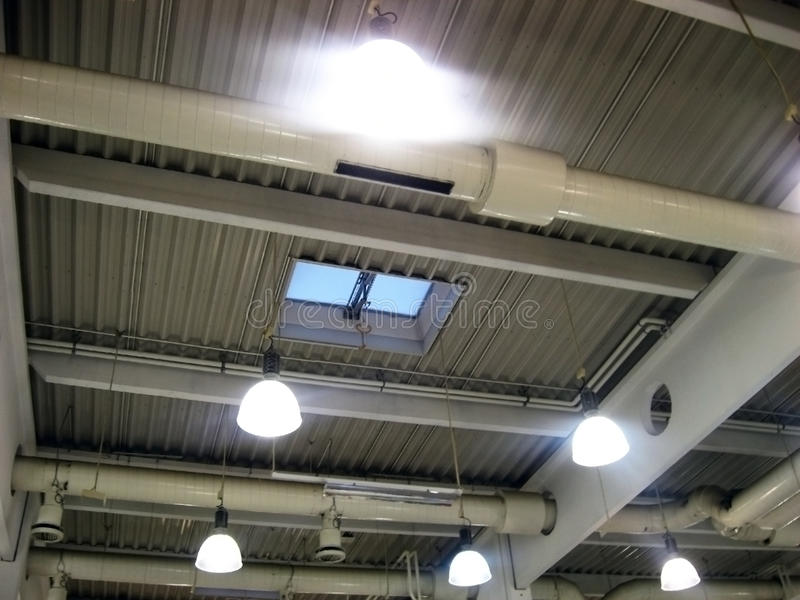 Ceiling lights. Ceiling lighting and windows at supermarket stock images