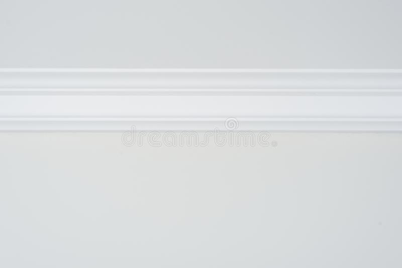 Ceiling moldings in the interior, detail of a flat ceiling skirting.  stock photography
