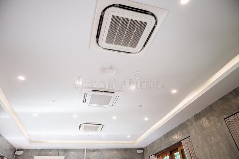 Ceiling mounted cassette type air conditioning system. Modern ceiling mounted cassette type air conditioning system royalty free stock photos