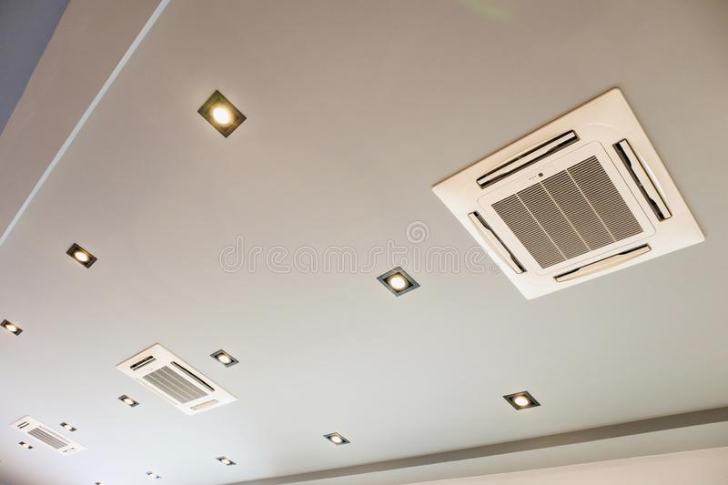 Ceiling mounted cassette type air conditioning system. Modern ceiling mounted cassette type air conditioning system royalty free stock photography