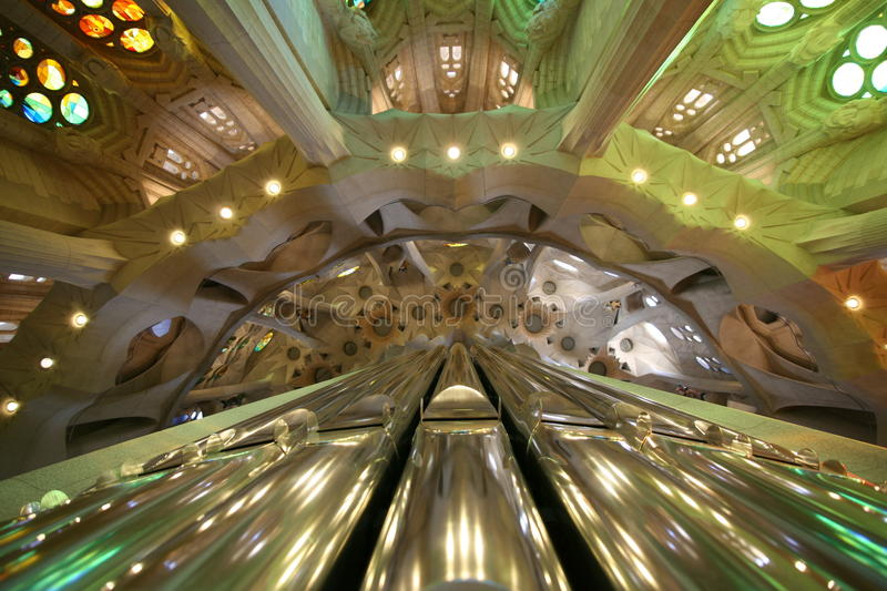 Ceiling and organ pipe of Sagrada Familia royalty free stock image