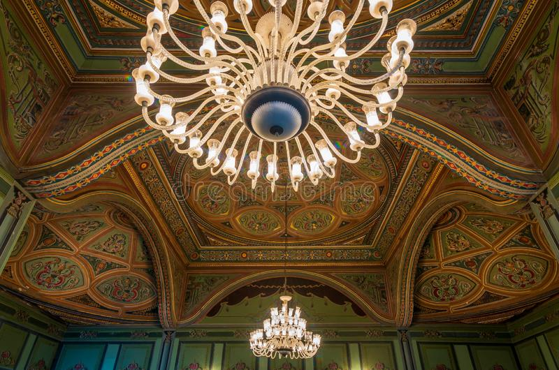 Ceiling at royal era historic Manasterly Palace decorated with colorful and golden floral paintings royalty free stock images
