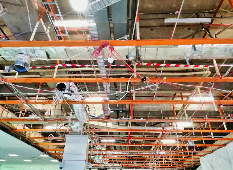 Exposed Ceiling Structure in Large Commercial Building. Ceiling structure, conduits and air conditioning pipes  in large open space commercial building, exposed stock image