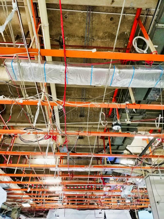 Exposed Ceiling Structure in Large Commercial Building. Ceiling structure, conduits and air conditioning pipes  in large open space commercial building, exposed royalty free stock photos