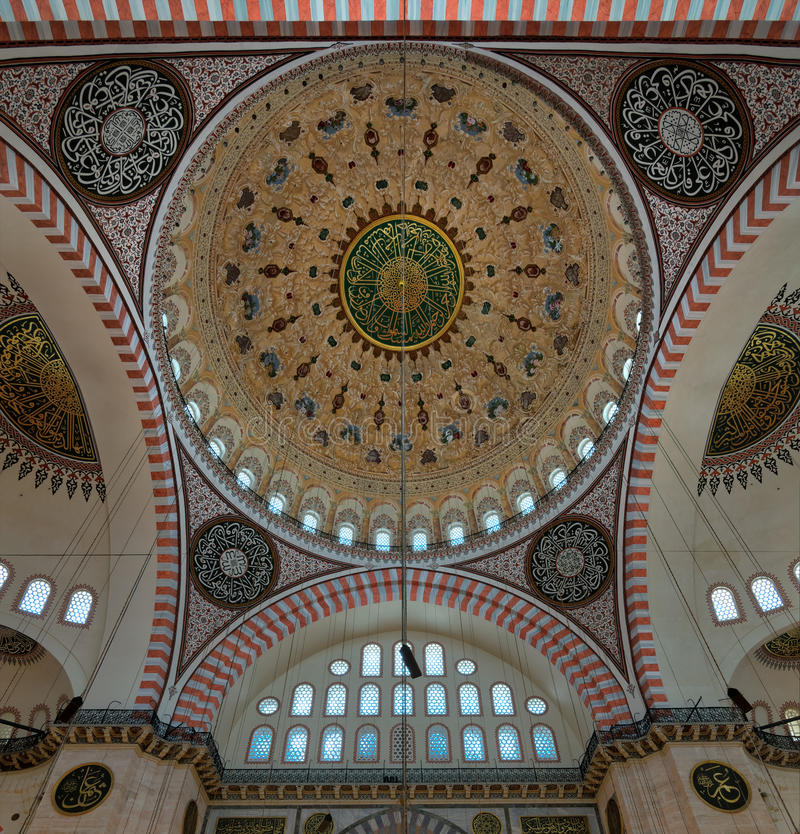Ceiling of Suleymaniye Mosque with main dome and intersection of three arches, Istanbul, Turkey. Decorated ceiling of Suleymaniye Mosque with main dome and royalty free stock image