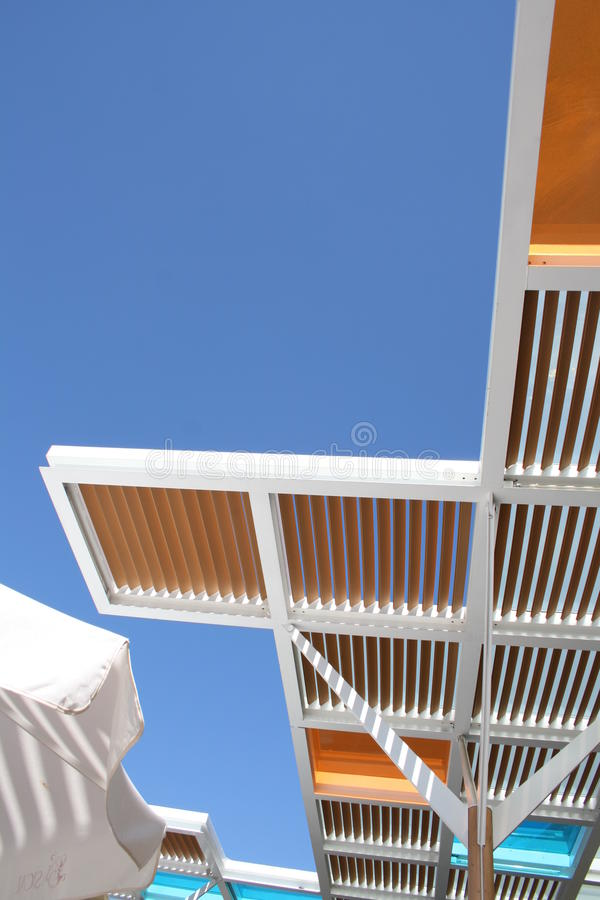 Ceiling tiles against blue skies stock photography