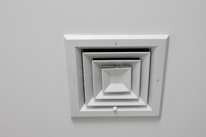 Ceiling Vent. Angled view of a ceiling air vent on a white ceiling royalty free stock photography