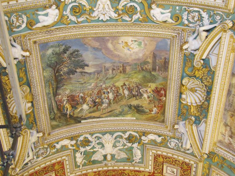 Vatican City has many beautiful frescoes and mosaics. The ceilings and walls within Vatican City have many gorgeous frescoes and mosaics displayed. Religious royalty free stock image