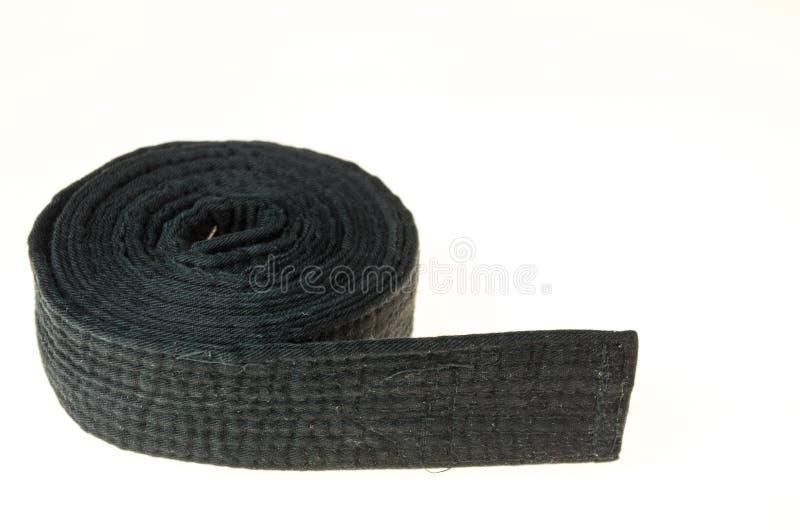 Ceinture noire d'art martial d'isolement sur le fond blanc images stock