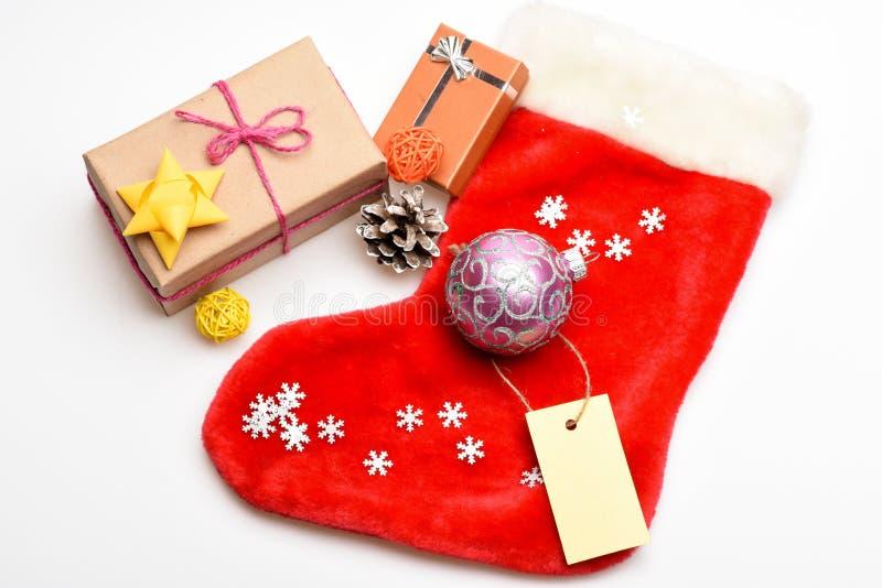 Celebración de la Navidad Contenido de la media de la Navidad Artículos pequeños que almacenan embutidoras o los pequeños regalos imagen de archivo