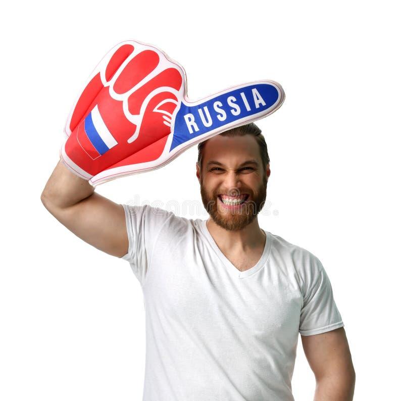 Celebración sonriente del finger ruso de la espuma del número uno del aficionado al fútbol feliz del hombre que lleva fotografía de archivo