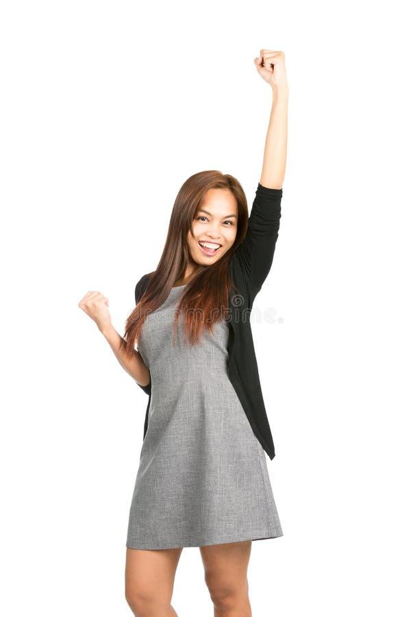 Celebrando il braccio di pompaggio del pugno femminile asiatico alzato immagini stock libere da diritti