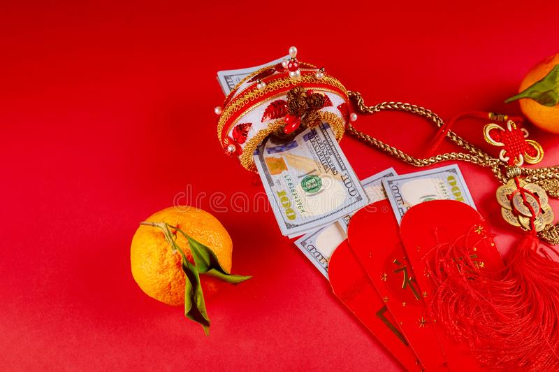 Celebrate Chinese New Year background with orange fruit and red envelope Ang Pau for U.S money stock photos