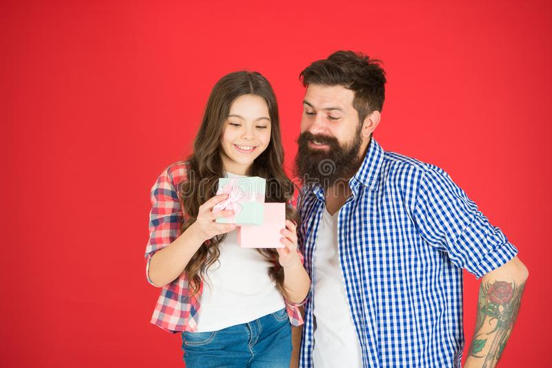 Celebrate fathers day. Family values concept. Friendly relations. Father hipster and his daughter. Gift surprise. Family. Celebration. Man bearded father and royalty free stock photos