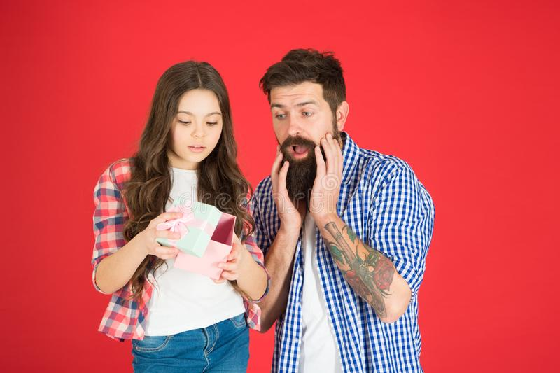 Celebrate fathers day. Family values concept. Friendly relations. Father hipster and his daughter. Gift surprise. Gift. For her dad. Man bearded father and cute stock photo
