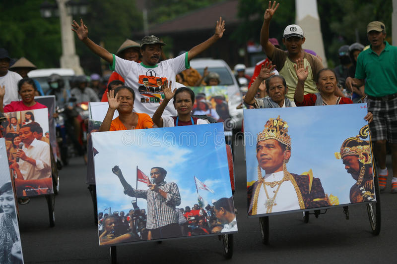 Celebrate for joko widodo. Poor people celebrate the victory of Joko Widodo as President in the elections the city of Solo, Central Java, Indonesia royalty free stock photography