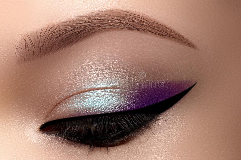 Celebrate Macro Eyes with Smoky Cat Eye Makeup. Cosmetics and Make-up. Closeup of Fashion Visage with Liner, Eyeshadows royalty free stock images