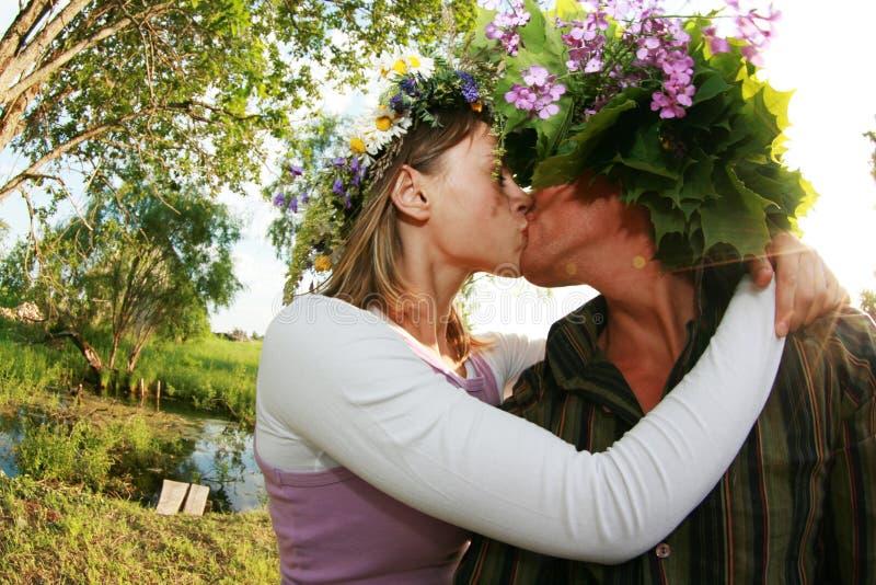 Celebrate midsummer night. Of Ligo in Latvia. Couple kissing royalty free stock photos