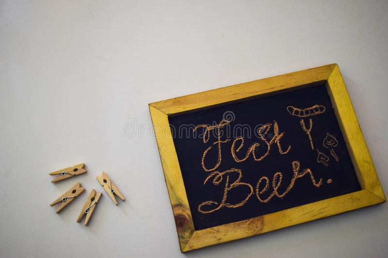 Celebrate october festival - clothes pins on grey/white background and a chalkboard with the slogan `Fest Beer` stock photography