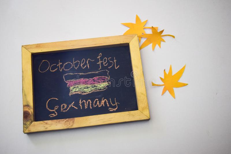 Celebrate october festival - clothes pins on grey/white background and a chalkboard with the slogan `October Fest Germany` royalty free stock photo