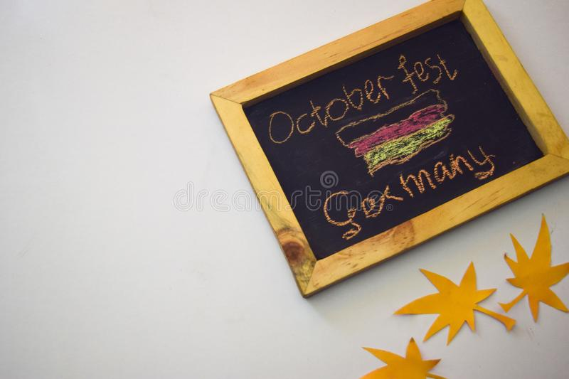 Celebrate october festival - clothes pins on grey/white background and a chalkboard with the slogan `October Fest Germany` royalty free stock image