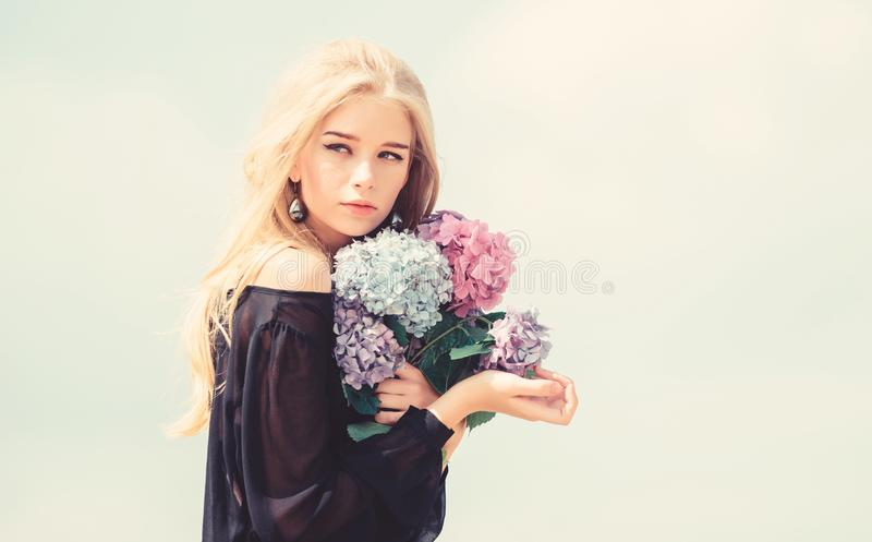 Celebrate spring with bouquet. Girl tender fashion model hold hydrangea flowers bouquet. Meet spring with fresh bouquet stock photo