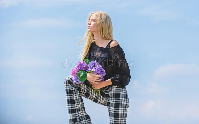 Celebrate spring. Gardening and botany concept. Girl fashion model carry hydrangea flowers. Spring fresh bouquet stock images