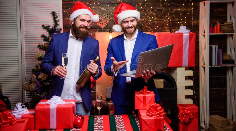 Celebrate successful year. Men business partners drink champagne. Business people drink champagne celebrate success. Colleagues celebrate new year. Review royalty free stock photography