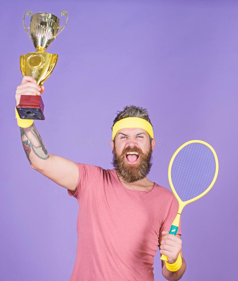 Celebrate victory. Tennis champion. Athletic man hold tennis racket and golden goblet. Win tennis game. Tennis player royalty free stock images