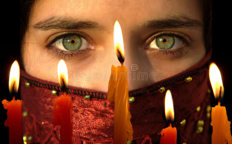 Celebrating. Light candles with a young ladyi's beautiful green eyes