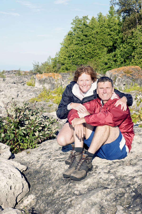 Celebrating an Adventure - Hiking the Bruce. Baby Boomers celebrate reaching the shores of Georgian Bay in Tobermory, Ontario after an arduous hike along The royalty free stock photos