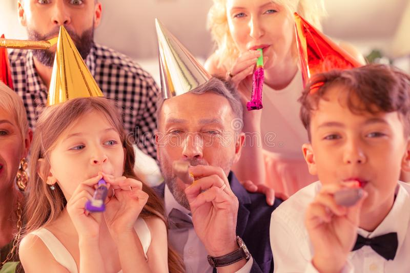 Children feeling excited while celebrating birthday with family royalty free stock photo