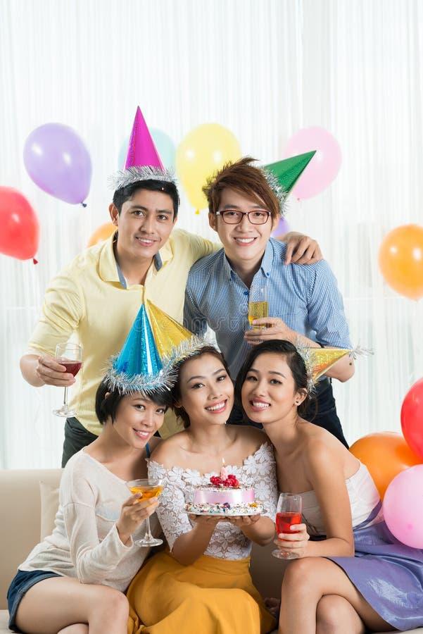 Celebrating birthday. Vietnamese young people celebrating birthday at home stock photos
