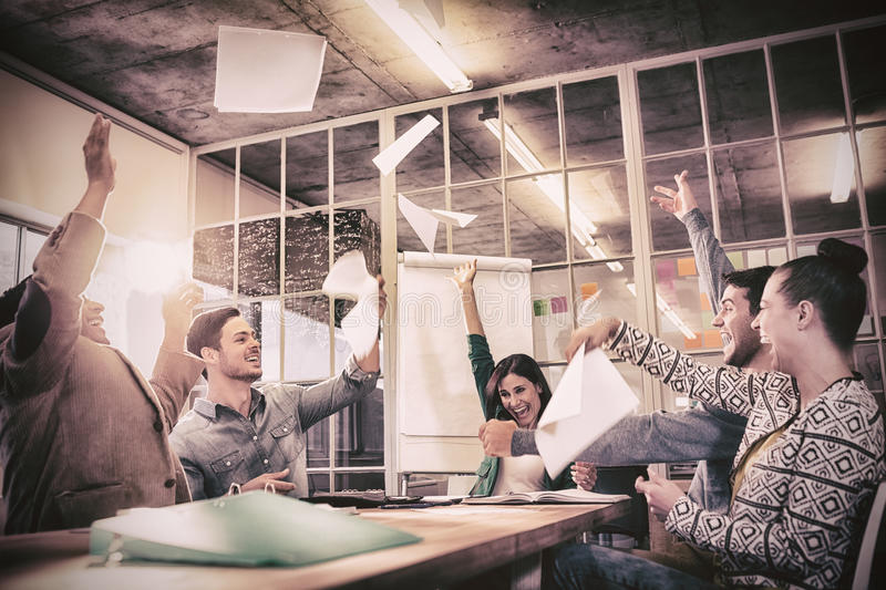 Celebrating business people throwing papers in the air royalty free stock images