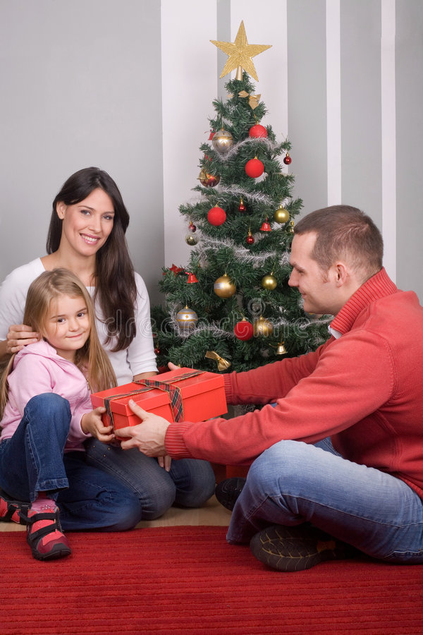 Celebrating Christmas. Family at home celebrating Christmas and New Year royalty free stock images