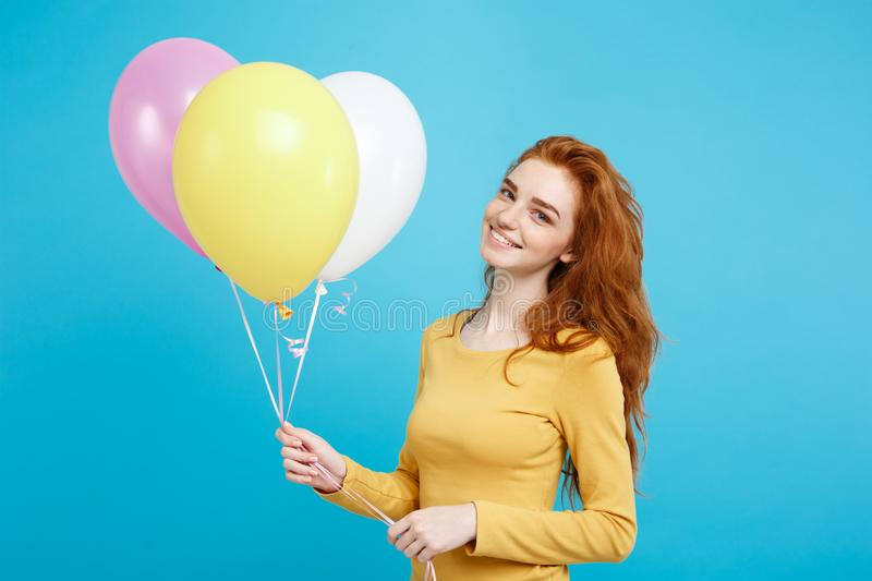 Celebrating Concept - Close up Portrait happy young beautiful attractive redhair girl smiling with colorful party stock photo