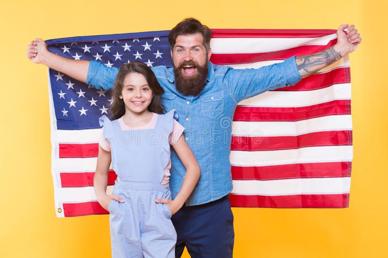 Celebrating the Independence every July 4th. Happy family commemorating anniversary of nations independence. Father and stock images