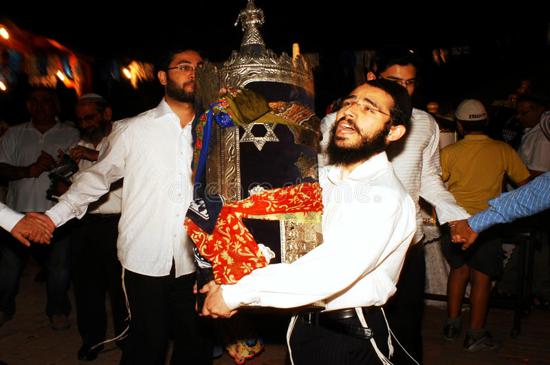 Celebrating Jewish Holiday Simchat Torah. SDEROT - OCTOBER 14:Orthodox Jewish Men celebrate Simchat Torah by dancing with the scrolls of the Torah at a Synagogue stock images