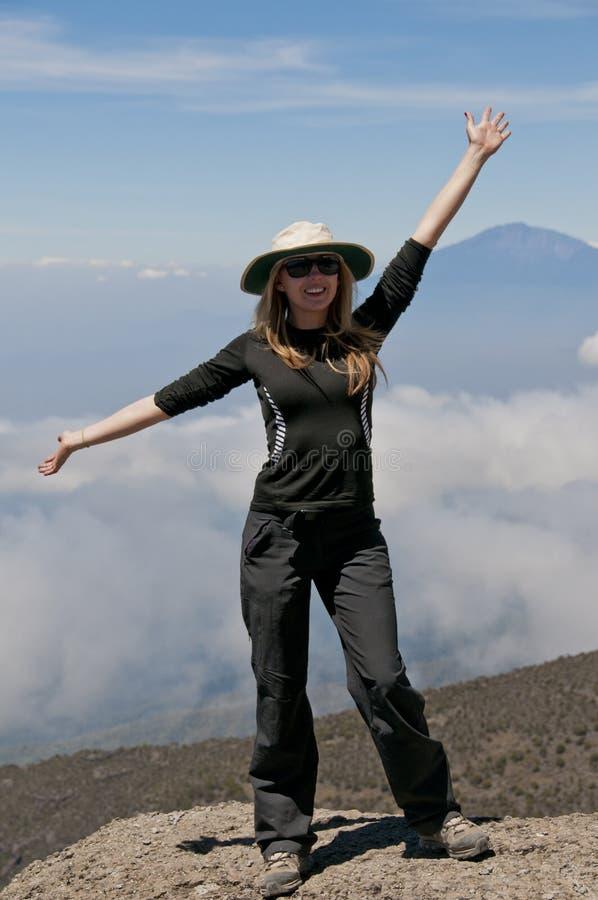 Celebrating on mountain side Kilimanjaro royalty free stock image
