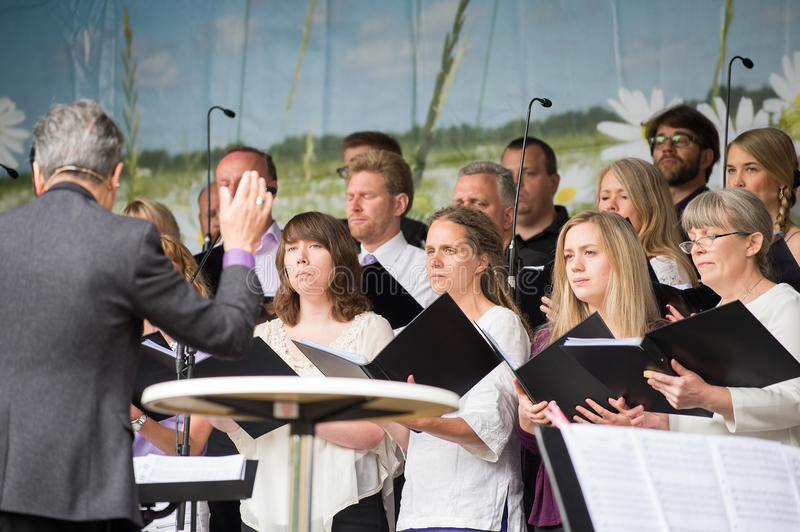 Celebrating the National day of Sweden. Norrkoping, Sweden - June 6, 2014: The Bel Canto choir entertains during National day celebrations in Norrkoping. The stock photo